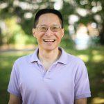 A headshot photo of Eric Liu.
