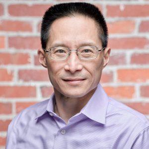A headshot of Eric Liu.